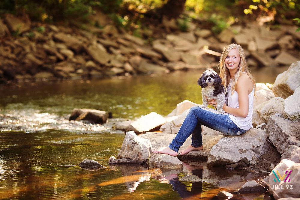 Maddie-with-dog-in-creek-senior-photos.jpg