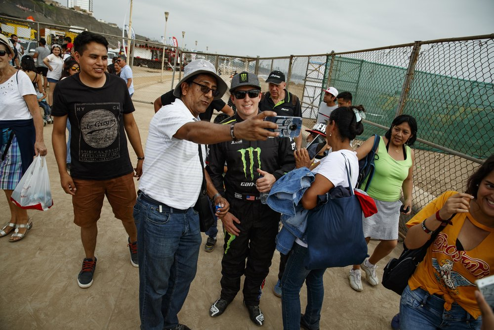 While walking over to the Podium Ceremony, Casey was bombarded with fans, each one wanting a photo.