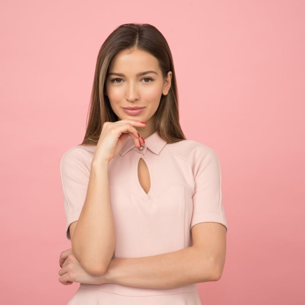 Woman-in-pink-resting-her-chin-on-her-hand.jpg