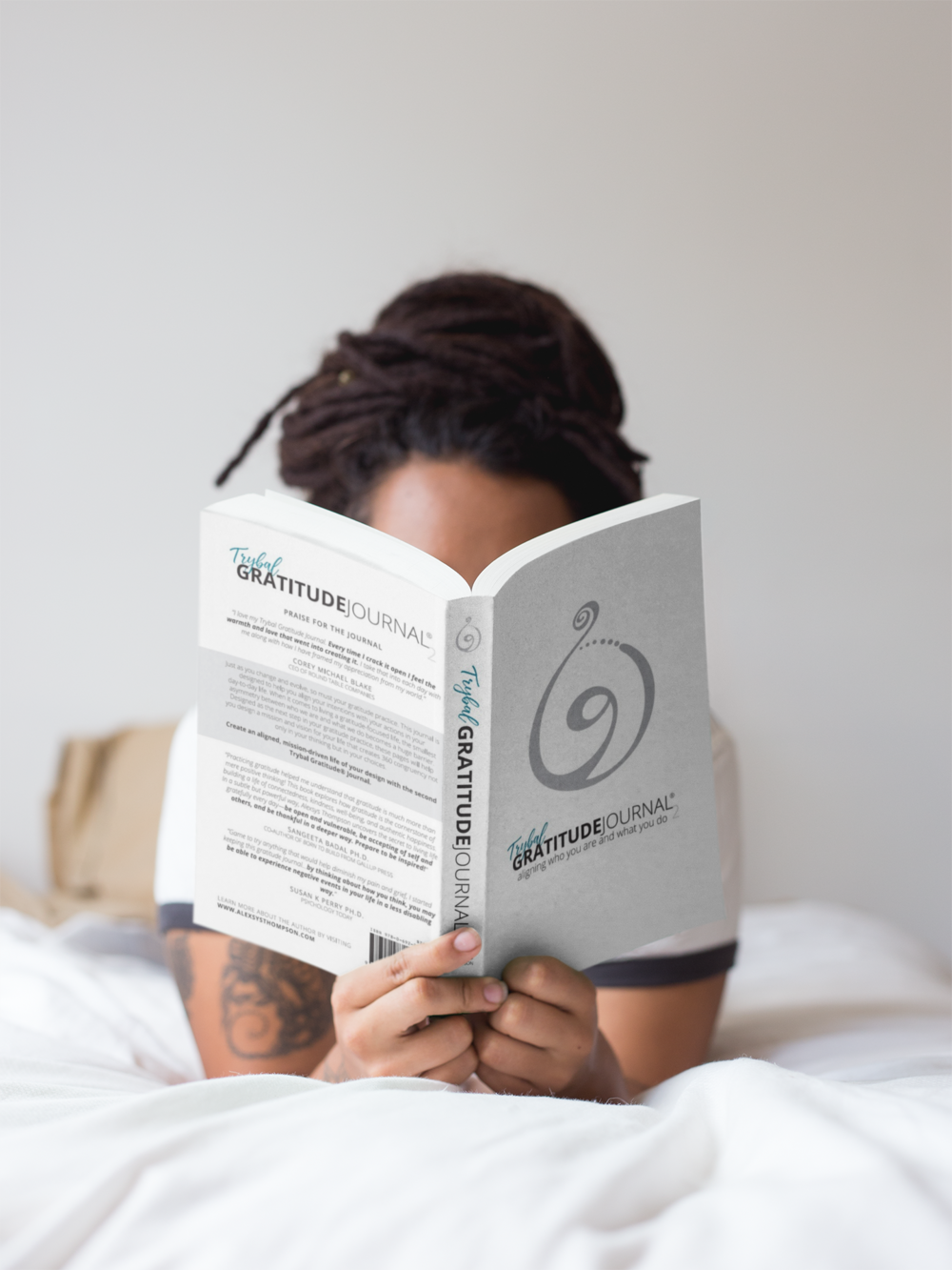 Girl and Journal on bed.png
