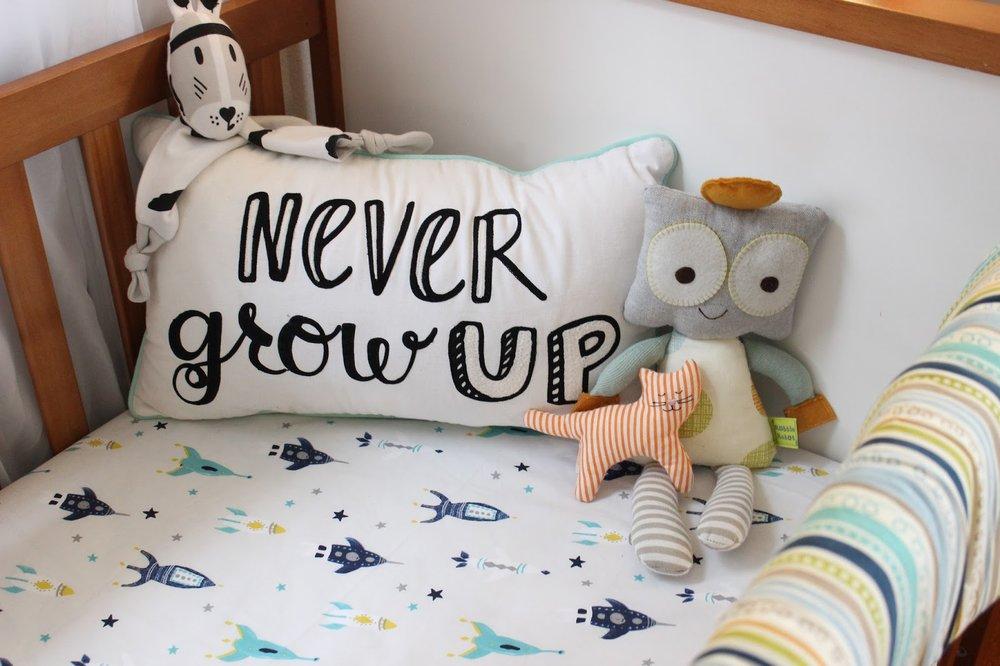 Never Grow Up Pillow:   Pillowfort for Target    Lovey:   River Kippin    Robot:   Robbie Robot from Lolli Living    Cat Rattle:   Ikea Leka