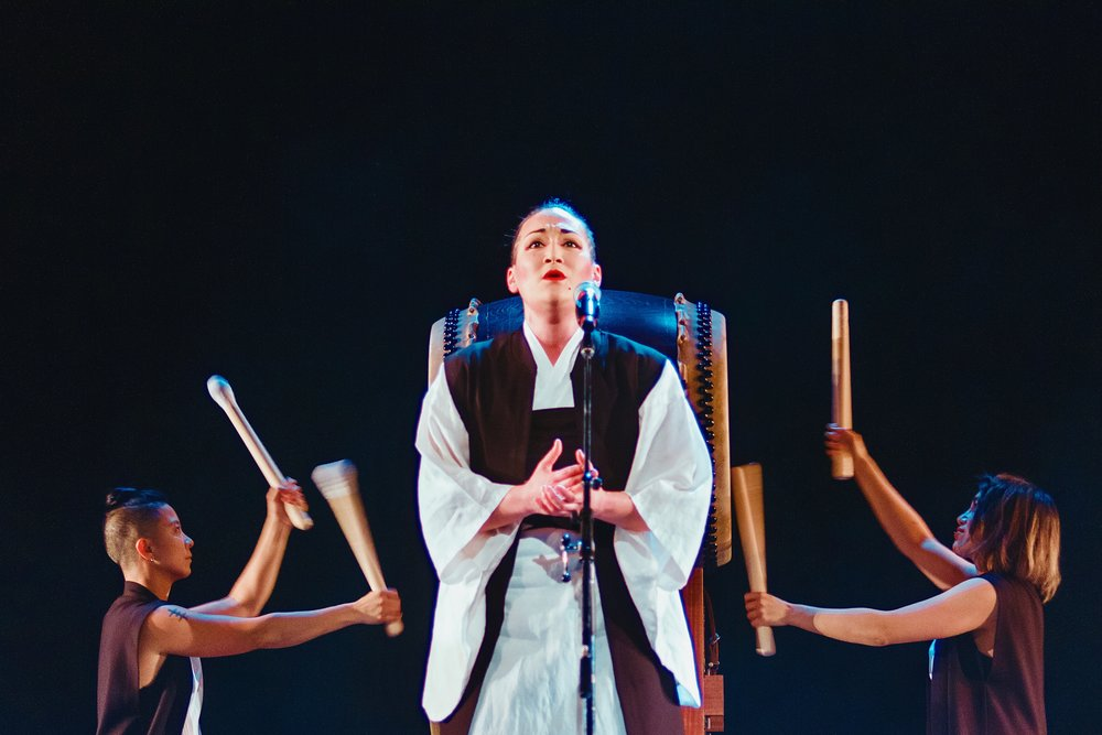 "(L-R) B-K Chan, Teiya Kasahara, Jayd Matyas, performing ""Shima Uta"" with Raging Asian Women Taiko Drummers at  Crooked Lines , Mar 2016. Photo Credit: TBA."