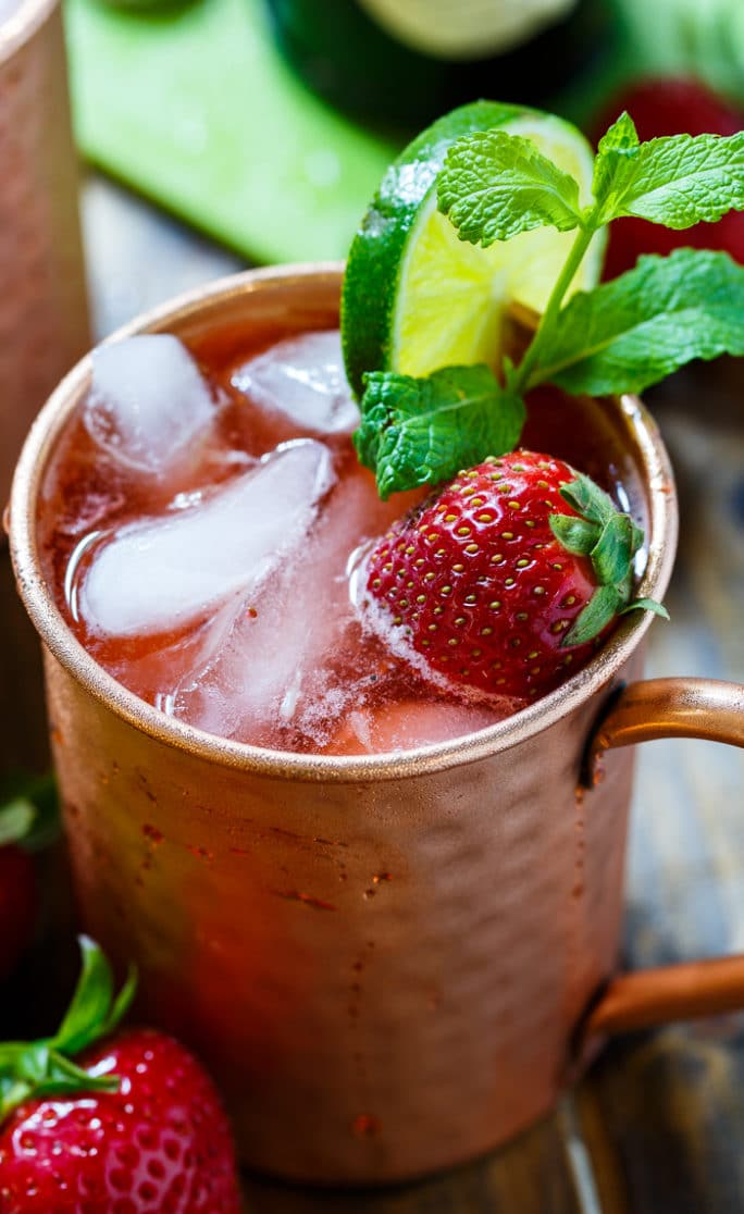 STRAWBERRY MOSCOW MULE   (SERVES 2)  3 oz South Fork Vodka  1/3 cup sugar  1/3 cup water  1 cup chopped fresh strawberries  2 tbs lime juice  1 bottle ginger beer  Combine sugar and water in a small saucepan and bring to a simmer, stirring to dissolve sugar. Add strawberries. Mash strawberries with a fork and let mixture simmer for 10 minutes.  Remove from heat and let cool. Pour mixture through a fine-meshed sieve into a bowl and press on mixture with a rubber spatula to get all liquid out.  Add 1/2 cup strawberry mixture to a pitcher along with lime juice and vodka. Stir well.  Add ginger beer and stir.  Pour into glasses or copper cups with ice.