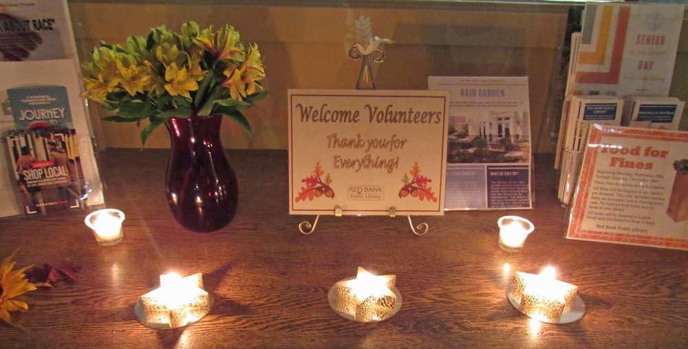 entrance with welcome sign and candles.jpg