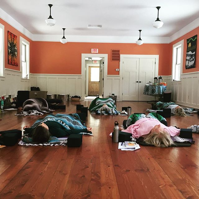Yes. We like to post pictures of peeps blissed out lying on the floor-so we all remember the glory of slumber. To rest. To go under ~ only to emerge nourished and reborn. . . @yogagurl11 and her #uglydollyoga crew threw down a Yin 1 Training Saturday sukha slowdown @dancingspiritranch worth it weight in freshly sprouted greens. . . Join us for our next Evoke Yin Yoga Nidra Experience & Yin II Training @namaspayoga April 27-28. . . #slowyerroll #yinisin #youcanhealthyself #evoketogetwoke