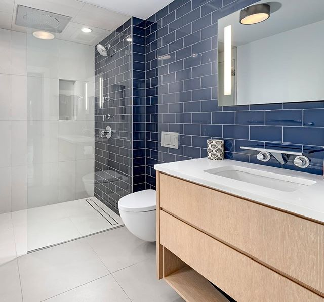 Tile Tuesday - navy subway edt.  The master bath in our West Loop project from a few years ago • • • @laurenfoxx16 📸:unknown  #tiletuesday #loft #renovation #westloop #subwaytile #daltile #moderndesign #interiordesign