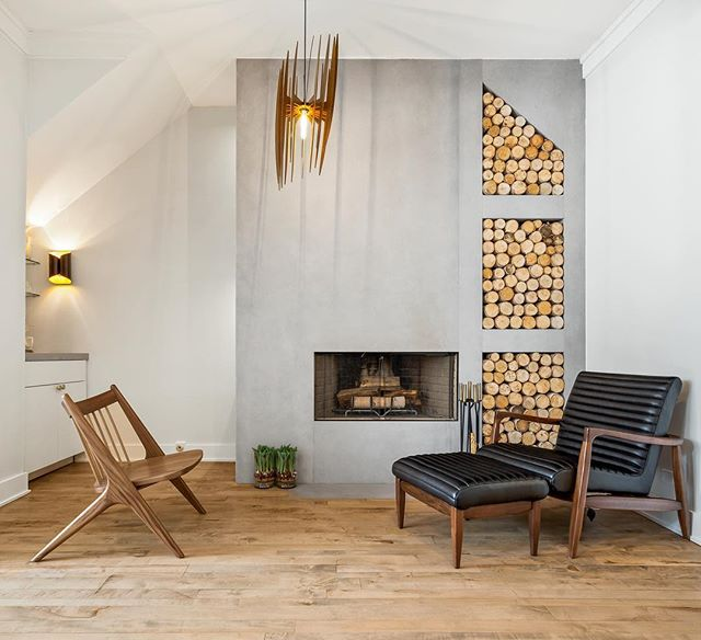 New wood burning fireplace wrapped in porcelain with storage in the side for dry bar necessities 🍸 *Added to the front room of the little Italy renovation project 🔥 . . . Construction: Greymark  Photography: @pdetphotography_architectural  Design: @resting_bish_face_  Stone/porcelain installer: @igmltd  #notforsale #littleitaly #renovation #addition #construction #design #interiorarchitect #porcelainslab #woodburning #customhome #fireplace #custombuild #qualityhomes #designchicago #chicagohomes