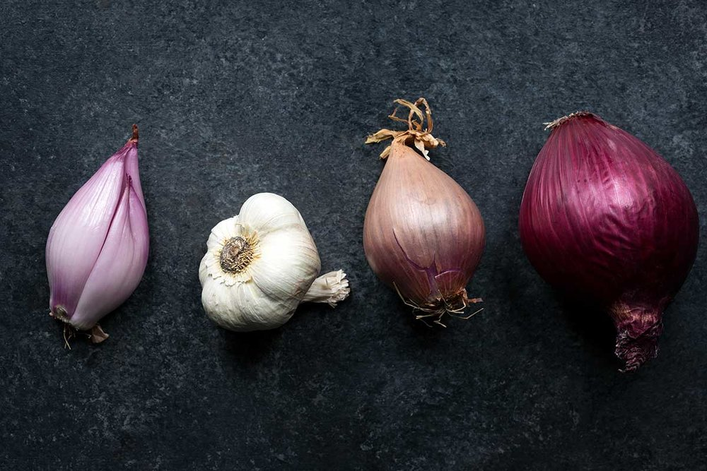 A head of garlic, a shallot, and a red onion for comparison. Credit: savory simple  Above: slow-roasted shallots from bon Appetit