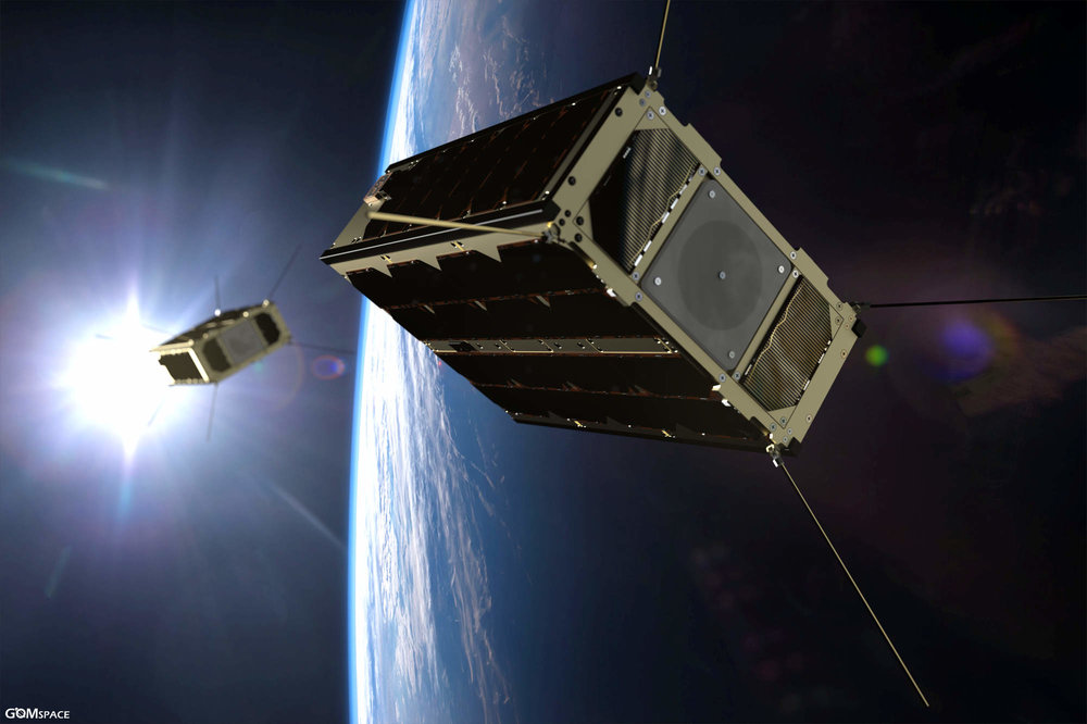 Artist rendering of the GomX-4 pair in formation around Earth - Credit: GomSpace