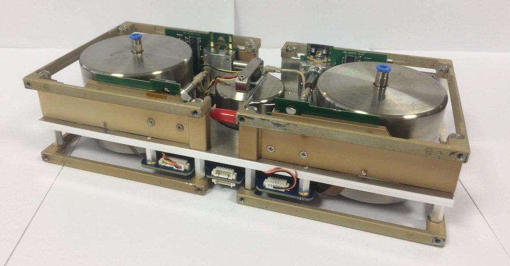 Butane cold gas thruster system used on the GomX-4B that has four 1 mN thrusters and two titanium tanks for storing butane. Takes up two half-CubeSat units in size. - Credit: Nanospace