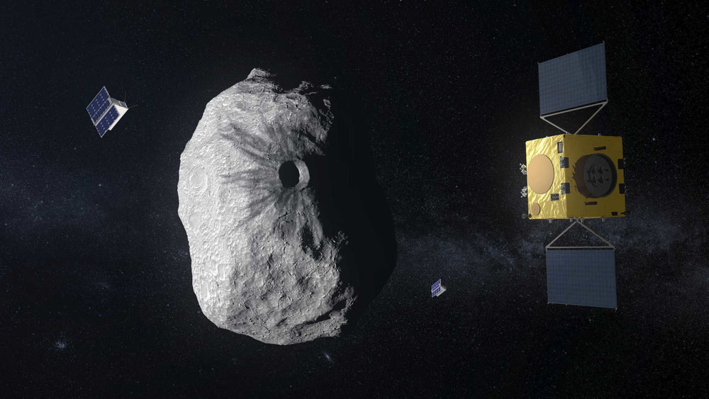 Artists graphic of the ESA Hera spacecraft orbiting the Didymos asteroid. The APEX and Juventas CubeSats are orbiting close to Didymos, studying the surface and interior characteristics in high detail. Credit: ESA - ScienceOffice.org
