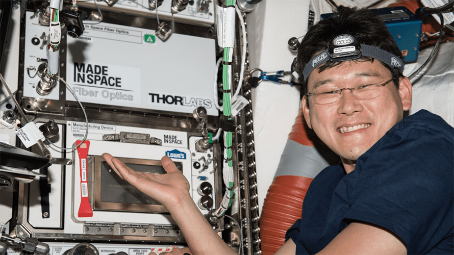 Made In Space Fiber Optics manufacturing system installed on-board the ISS, with JAXA astronaut Norishige Kanai. Credit: NASA