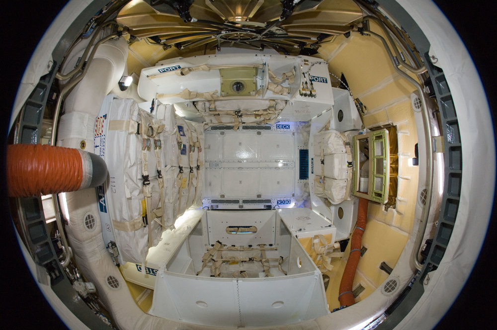 View into a SpaceX Dragon Commercial Resupply Services vehicle, docked to the ISS, from the perspective of the ISS. Credit: NASA