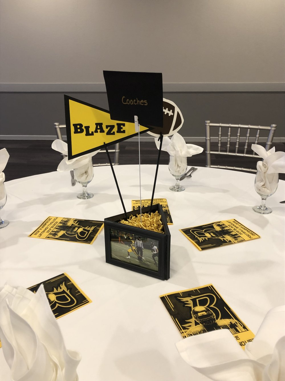 High School Banquet Hall in Eagan for sports award ceremony | Burnsville High School Football | triangle frame centerpiece with mini flags