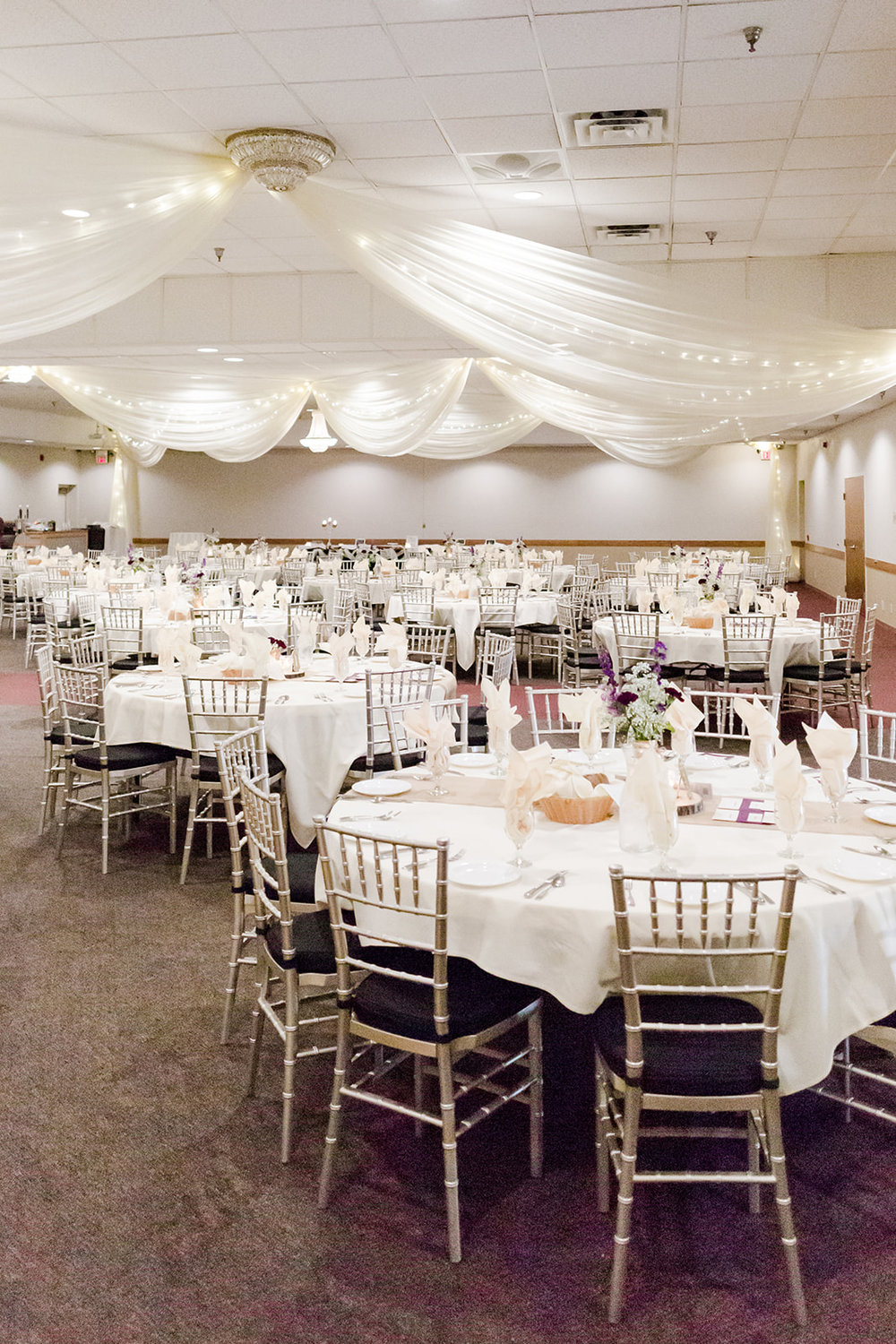 Photo by Lindsey White Photography | Social Events banquet hall at Royal Cliff south metro Minnesota | round tables