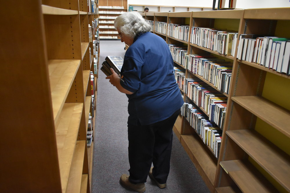 Staff processing books from our adult fiction collection