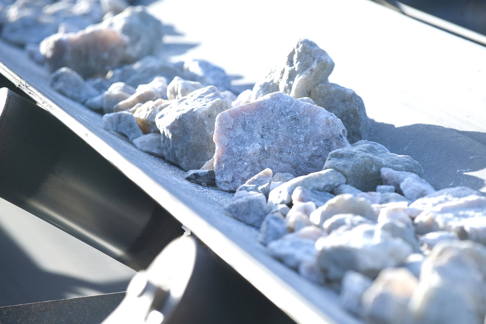 Talison crushed lithium ore on conveyor.jpg