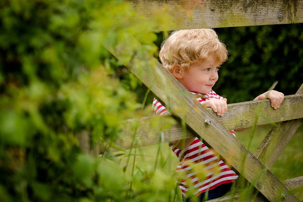 leeds-portrait-photographer-young-boy-fence.jpg