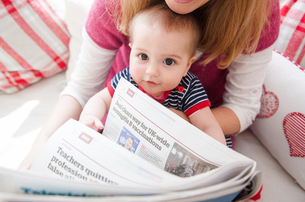 jma-photography-baby-holding-newspaper.jpg