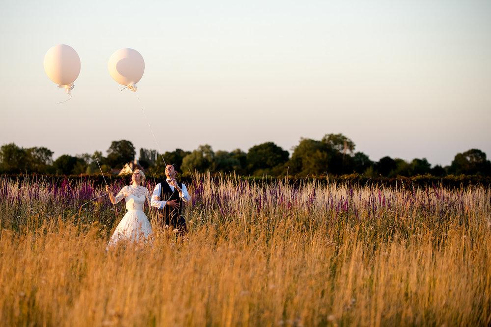 JMA-photography-bride-groom-carrying-big-balloons.jpg