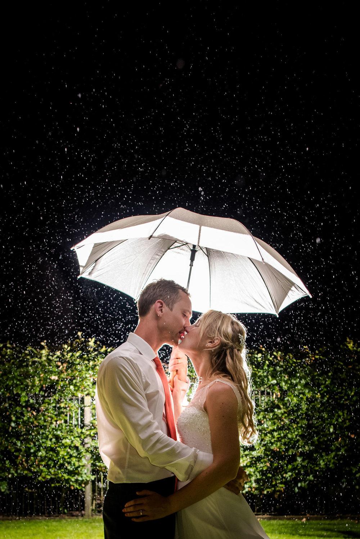 wedding-couple-kissing-rain-jma-photography.jpg