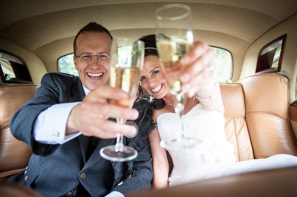 bride-groom-beaming-toasting-champagne.JPG