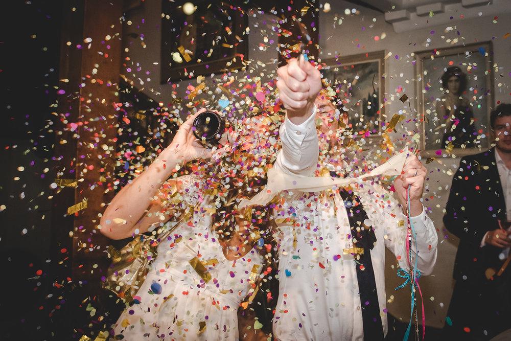 wedding-couple-popping-confettie-balloon-yorkshire-wedding-photographer.jpg