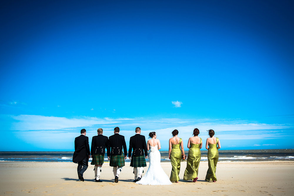 jma-photography-leed-wedding-party-walking-beach.JPG