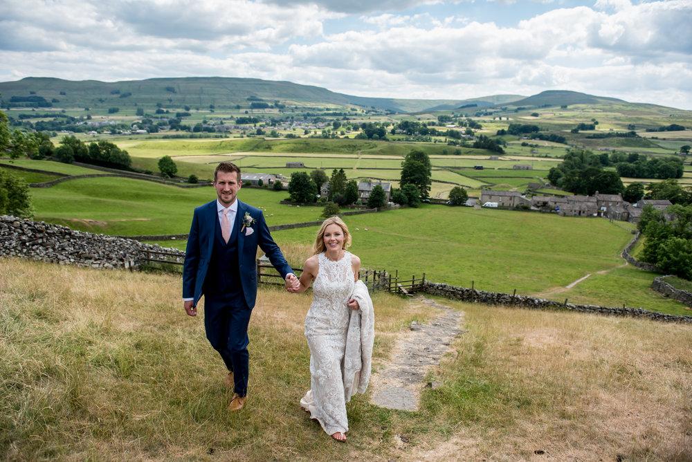 JMA-PHOTOGRAPHY-YORKSHIRE-WEDDING-COUPLE-WALKING-DALES.jpg
