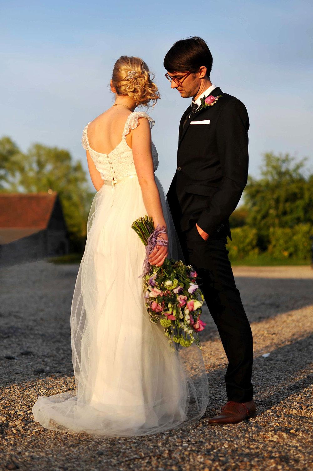 JMA-PHOTOGRAPHY-WEDDING-LEEDS-COUPLE-STANDING-IN-SUN.jpg