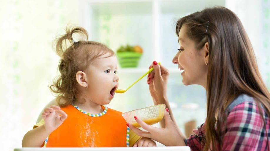 mother-feeding-toddler-918x516.jpg