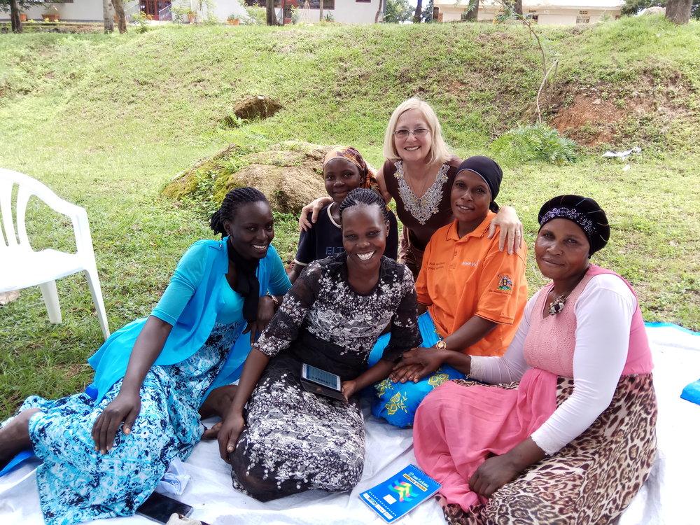 Ilana Shemesh with Ugandan family.jpg