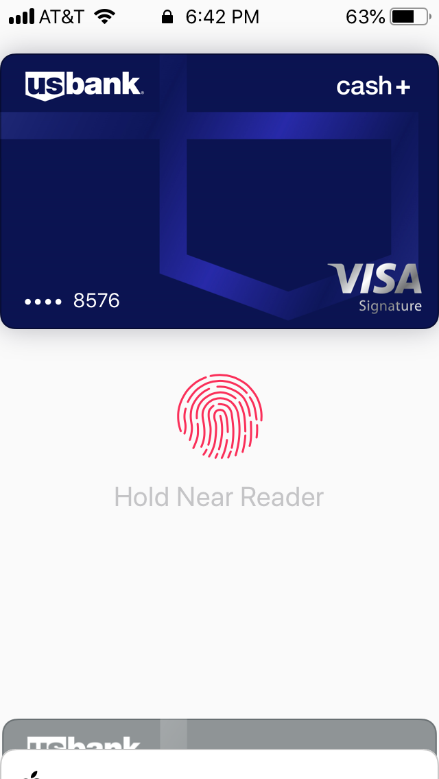 Apple Pay shows a default card on top with other cards on the bottom during payment