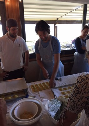 Fast forward, the photo shows Franco conducting a ravioli cooking class at the vineyard with Chef Mirco Malevolti in 2016.