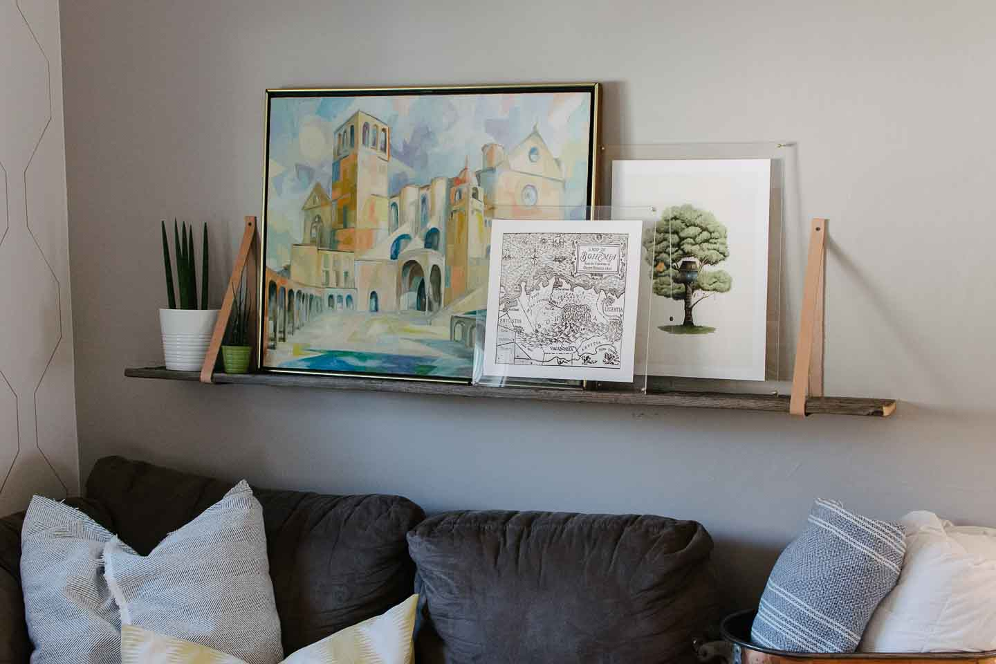 A Simple, Stunning, And Affordable DIY frame for art made with plexiglass and brass hardware