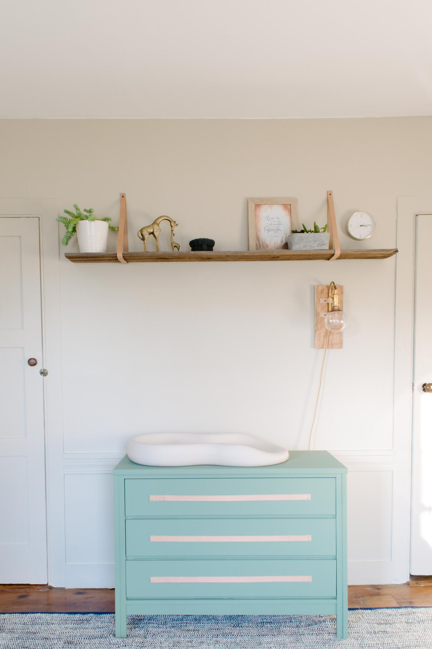 Reclaimed Shelf |Green Dresser | Mid-Century Dresser | Leather Pull Dresser | Natural & Soothing Boy's Nursery Reveal | Brass, Leather, and Green touches in a little boy's nursery | Geometric Nursery | Mid-Century Nursery | Baby Nursery | Modern and Natural Boy's Room | Green Dresser | Green Changing Table |