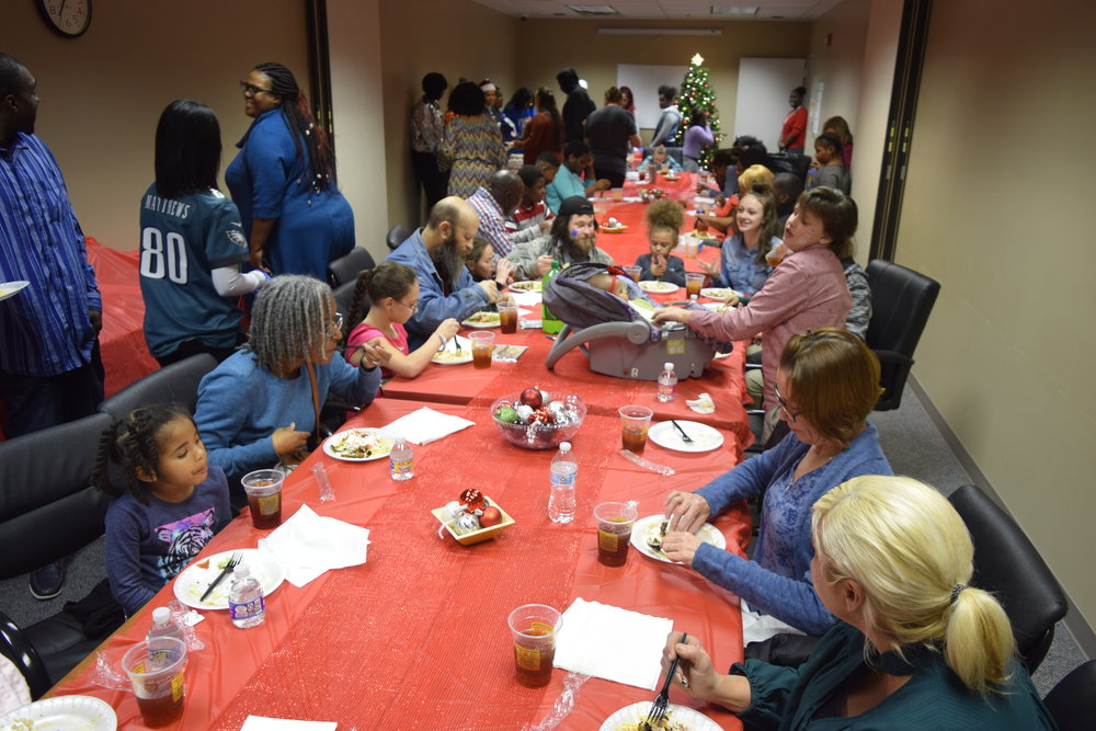KJIF partnered with local NFL moms to provide a night of food, fun, and gifts to families in need in Huntsville, AL.