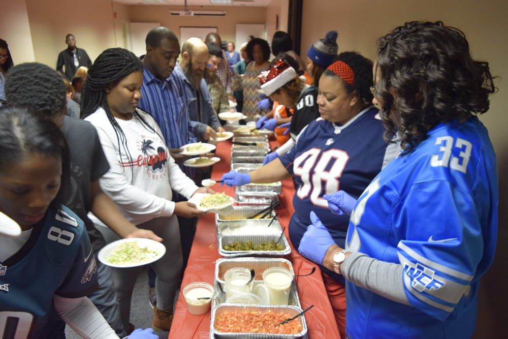 KJ IF President, Natalie Johnson, serving local families with other NFL moms during the holiday season.