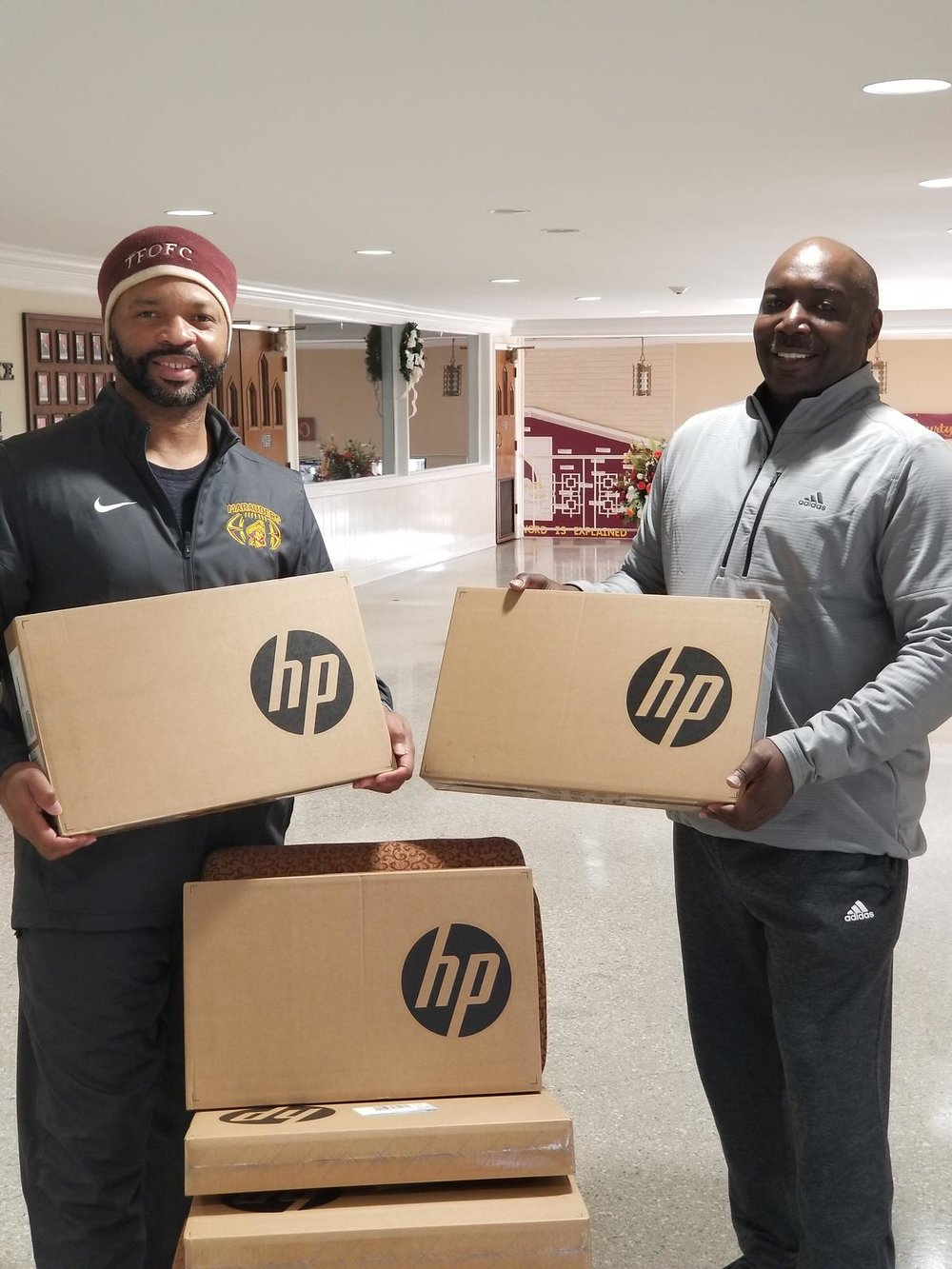KJIF Vice President, Kerry Johnson, delivering computers to help with the Fellowship of Faith Workforce Development Program.