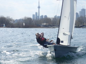 An RS Vision fast with the CN Tower in the background and instructors sailing