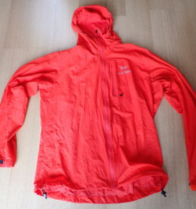 A simple wind breaker or rain jacket that you have at home already is great to keep the wind and water out