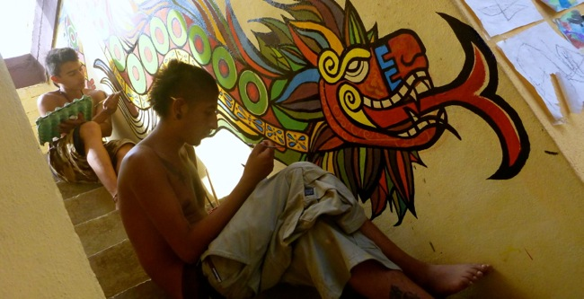 boys painting mural