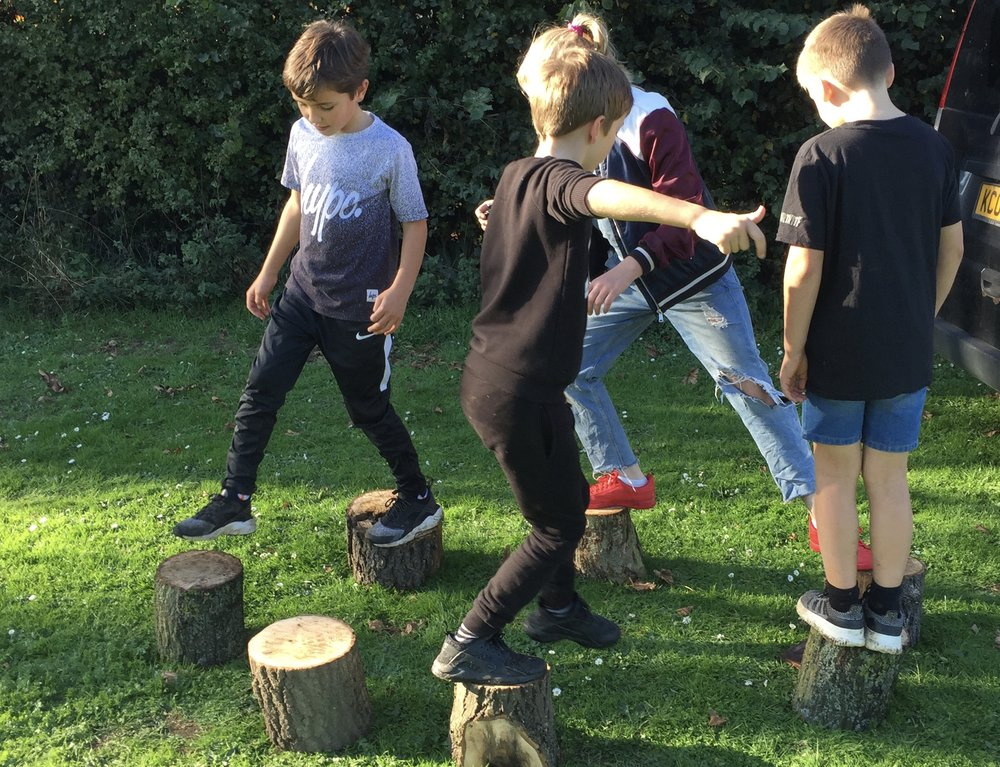 The children invented a 'Stepping Stone Maths' game. Intellectual, physical, coordination, agility, teamwork, communication, social and emotional development.