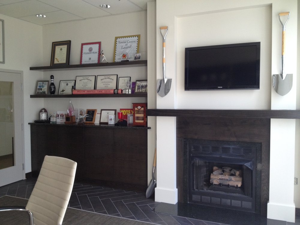 Floating shelves and fireplace.JPG