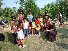 Dr. Suzanne Levine posing with the children with their new shoes.