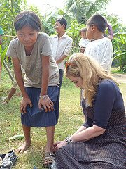 Dr. Suzanne Levine helping a boy to find a pair that will help protect his feet every day.