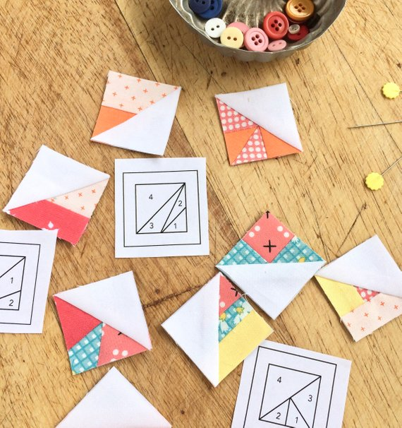 Why Scrappy Triangles ? - Because they are fun! The foundations make it easy to sew the tiniest of triangles so they turn out perfectly every time. No frustration and seriously addictive!Because you can use your scraps! One of the funnest parts about making Scrappy Triangles is digging through my scrap basket and choosing all the leftover snippets of favorite fabrics. That's what being a quilter is all about - playing with fabric!