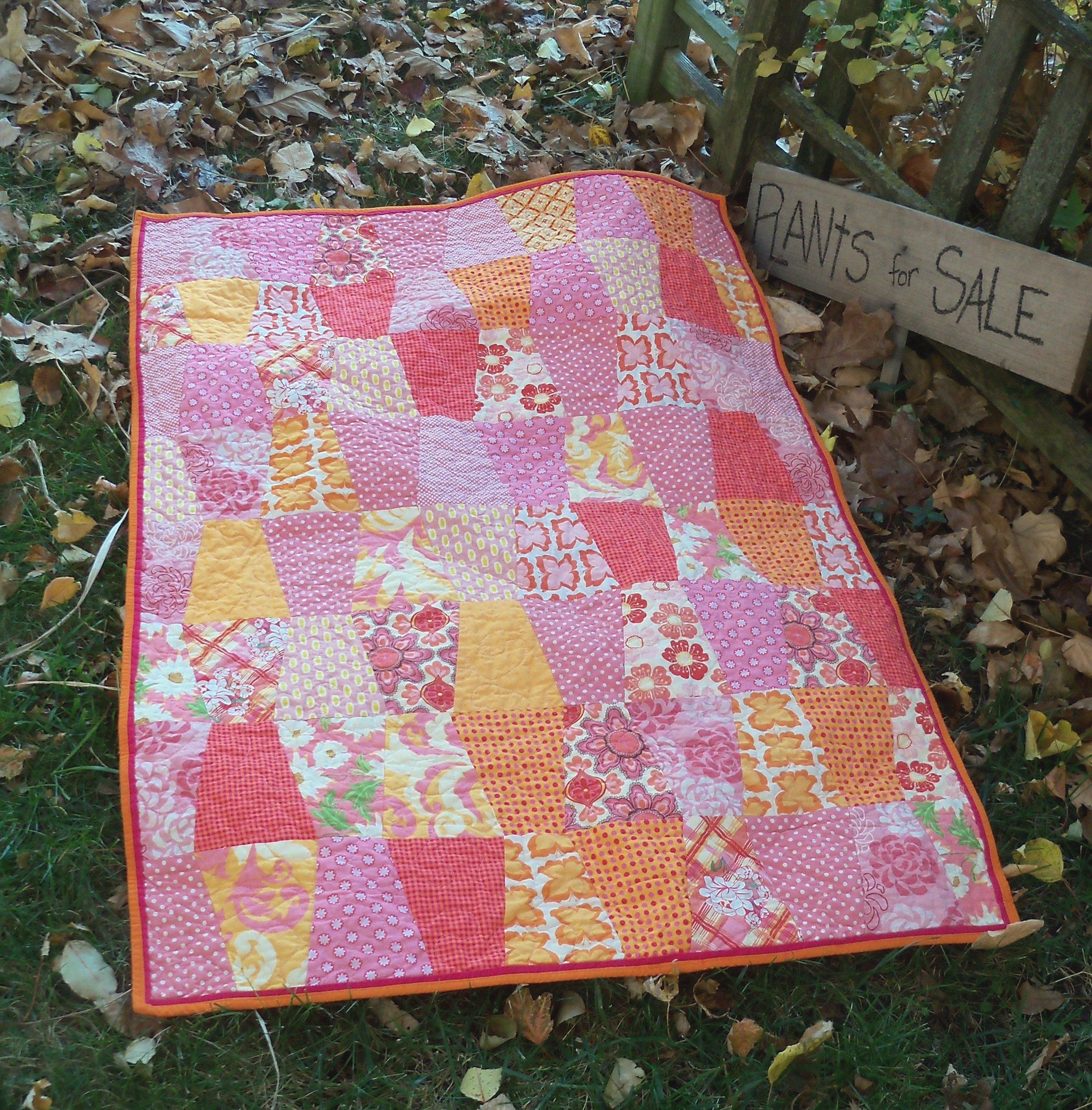 orange pink tumbler quilt.JPG