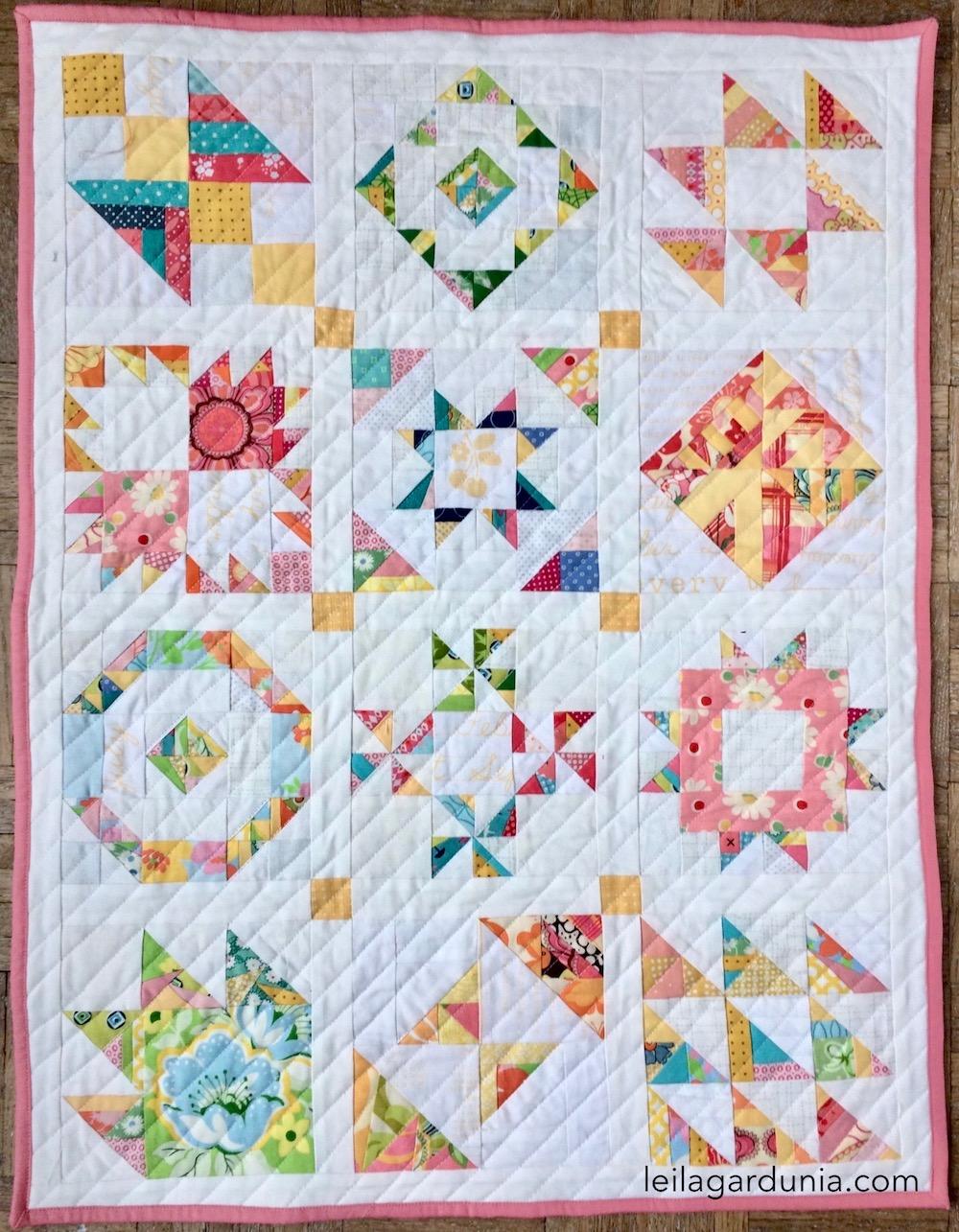 tiny piecing sampler mini quilt.jpg