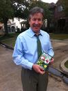 Bush Spokesman Jim McGrath taking the DVD to George Bush